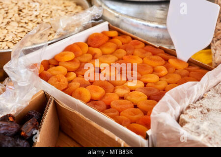 Pile of dried apricots with empty price tag in an authentic bazaar - Stock Photo
