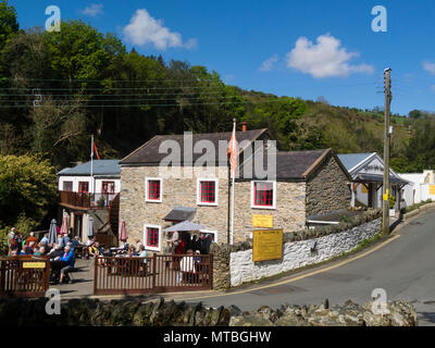 Visitors sitting in the sunshine dining out in Ballacregga Tearooms and Restaurant next to Salmon Lake Centre Laxey Isle of Man - Stock Photo