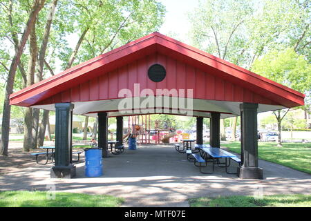 Eating shed in Golf Mill Park playground in small-town Niles, Illinois on a hot sunny summer day. - Stock Photo