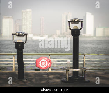 Two viewfinders on the tip of a pier overlooking the Hudson River in New York City - Stock Photo