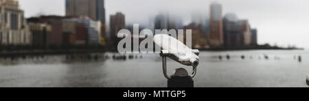 Viewfinder  overlooking lower Manhattan covered in fog - Stock Photo