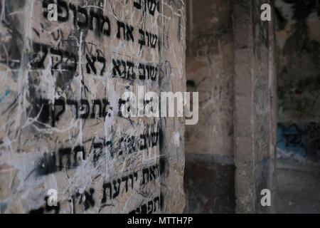 A romantic poem in Hebrew written in a wall inside a house which still remain standing in the depopulated Palestinian village of Lifta on a slope at the entrance to Jerusalem. The population was driven out during Israel's 1948 War of Independence. The village is one of the few abandoned Palestinian villages to be frozen in time; most of the rest were either demolished or repopulated by Jewish residents. - Stock Photo