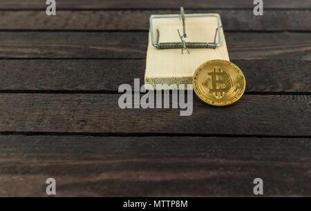 Bitcoin in mouse trap, financial trap concept - Stock Photo