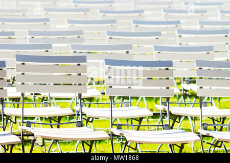 White chair rows in a spa park dark light - Stock Photo