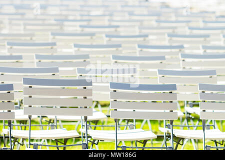 White chair rows in a spa park in bright light - Stock Photo