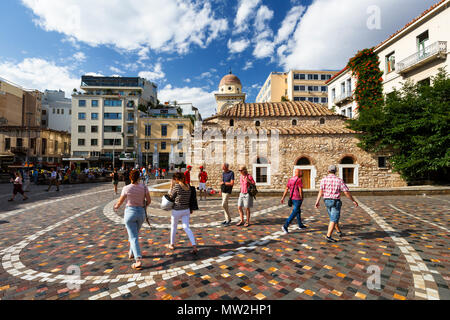Athens, Greece - May 30, 2018: Tourists at a church in Monastiraki square in the old town of Athens, Greece. - Stock Photo