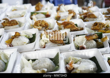 Vendor selling Crispy Fried chicken during fasting month at Street market food in Banda Aceh, Indonesia - Stock Photo