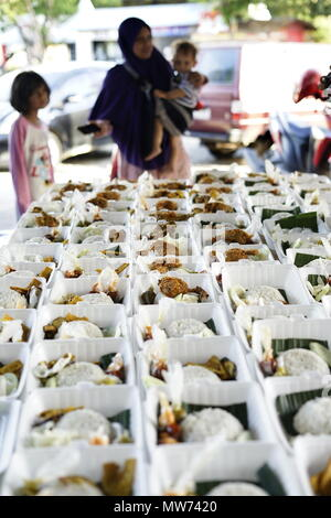 Banda Aceh, Indonesia - May 31, 2018: Customer buying Crispy Fried chicken during fasting month at Street market food in Banda Aceh, Indonesia - Stock Photo