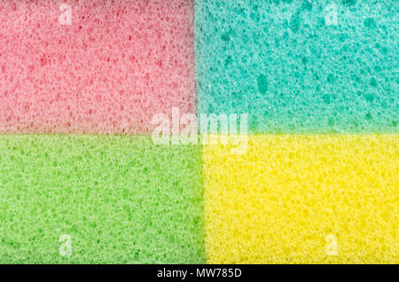 Background of the four colored sponges for washing dishes, close-up - Stock Photo