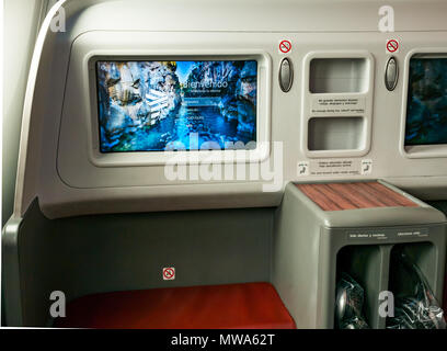 Business Class seats LATAM airlines Dreamliner 787 flying from Easter Island to Santiago, with welcome video console - Stock Photo