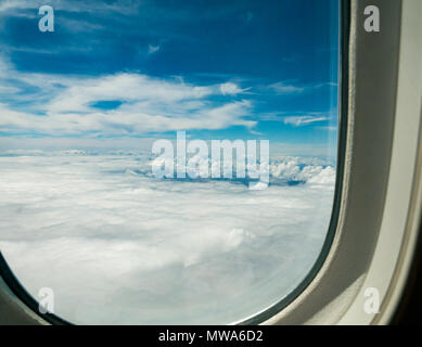 View from LATAM airlines Dreamliner 787 business class seat through window overlooking Pacific Ocean between Easter Island and Chile - Stock Photo