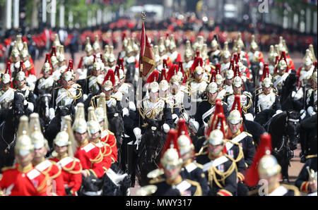 Members of the Household Cavalry make their way down The Mall after taking part in the Colonel's Review, the final rehearsal of the Trooping the Colour, the Queen's annual birthday parade, takes place in Central London. - Stock Photo