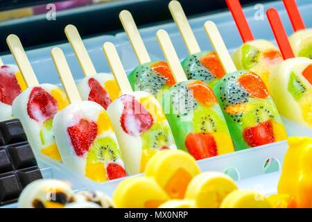 arranged freshy fruity; kiwi, strawberry, berry, dragon fruit, papaya, mango, mint, chocolate, milk, orange, pineapple ice-cream stick, frozen in froz - Stock Photo