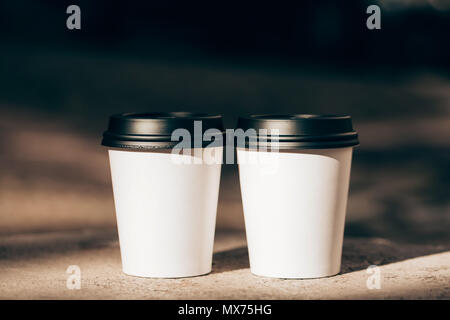 Two cups of coffee to go - Stock Photo