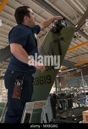 Thomas Martinez, 54th Helicopter Squadron aircraft mechanic, prepares to drain oil from a gear box at Minot Air Force Base, N.D., May 2, 2017. Squadron members also engage in emergency search and rescue mission training. - Stock Photo