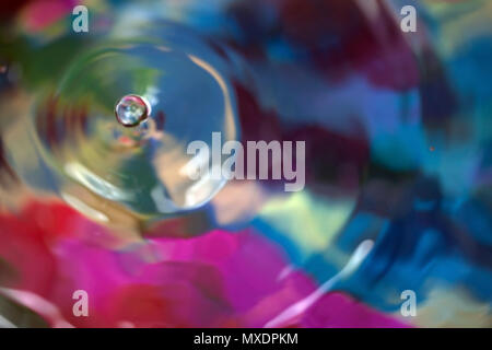 Color motion drop in water, abstraction blurred - Stock Photo