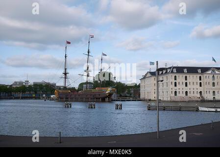 Amsterdam, Netherlands - May 17, 2018: view of Het Scheepvaartmuseum (Maritime museum) and VOC-schip De Amsterdam - Stock Photo