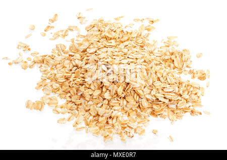 Pile of oat flakes isolated on white background. Top view - Stock Photo