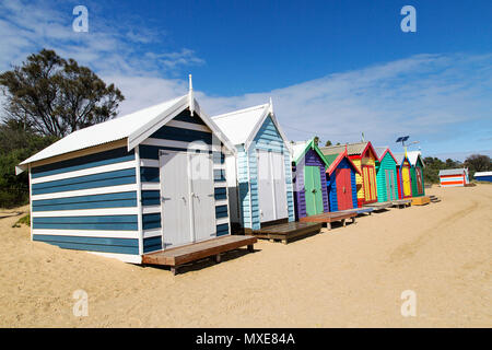 Front view of the Bathing Boxes on Melbourne's Brighton Beach. The bathing boxes have a rich heritage back to the 19th century and are much sort after - Stock Photo