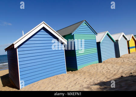 Rear view of the Bathing boxes on Melbourne's Brighton Beach. The bathing boxes have a rich heritage back to the 19th century and are much sort after. - Stock Photo