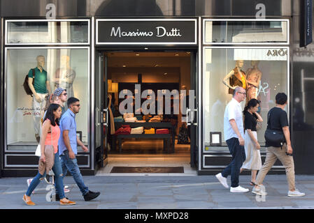 Tourists and shoppers walk past a branch of Massimo Dutti, the women's clothing retailer, owned by Inditex, in Covent Garden, London. - Stock Photo