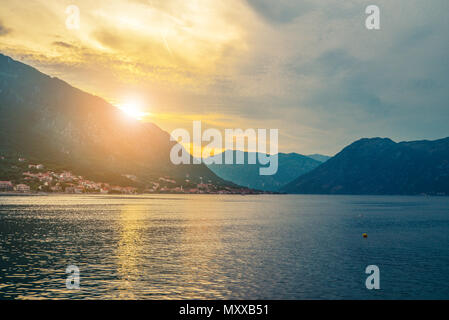 Beautiful view of the sunset in the mountains in Kotor Bay, Montenegro - Stock Photo