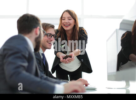 young business woman shows business team fresh sprout - Stock Photo