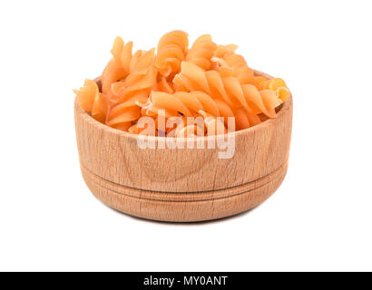 Wooden bowl with pasta fusilli on white background - Stock Photo