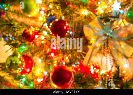 Blurred image. Beautiful Christmas tree and colorful light bokeh , Christmas and Happy new year on blurred bokeh , Christmas background, Winter season - Stock Photo