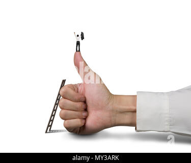 Cheering businessman standing on top of thumb, isolated on white background. - Stock Photo