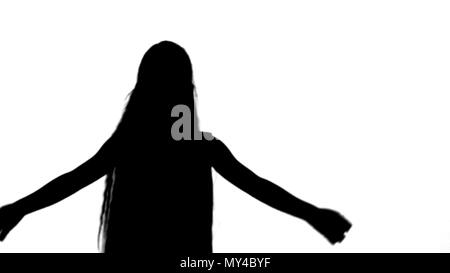 Silhouette Cute little girl singing a song and dancing track matte - Stock Photo
