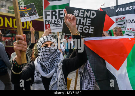 June 5, 2018 - London, UK. 5th June 2018. Protesters at Downing St on the National day of solidarity actions for the Great Return March in Palestine call for freedom for Palestine and an end the the shooting of Palestinians by Israeli forces. They urged the government to stop supplying arms to Israel and supported the rights of Palestinians to return to their former family homes. Many came with Palestinian flags and bunches of keys to symbolise the right to return to the homes which people were forced to leave seventy years ago in the 1948 Nakba when the state of Israel was formed. After a ral - Stock Photo