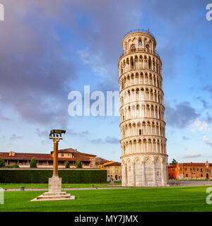 Medieval Leaning Tower of Pisa (Torre di Pisa) at Piazza dei Miracoli (Piazza del Duomo), famous UNESCO World Heritage Site and top tourist attraction - Stock Photo