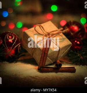 Christmas gift and Christmas tree decorations on the background  - Stock Photo