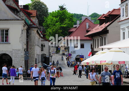 Kazimierz Dolny, Lublin Voivodeship, Poland, May 2018 - Tourists and city architecture at the market square - Stock Photo