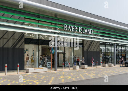 Exterior of River Island, a fashion retailer; Rushden Lakes Shopping Centre, Northamptonshire, UK - Stock Photo