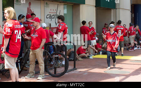 Washington, USA. 7th June, 2018. Fans lined up for a Capitals hockey game clad in Caps gear in Washington D.C., USA. Credit: Jonathan Densford/Alamy Live News. - Stock Photo