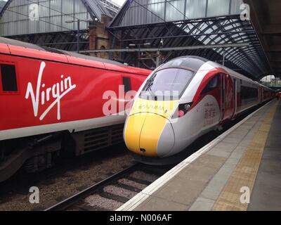 London, UK. 18th March, 2016. New IEP Virgin Train 800101 in Virgin colours at London Kings Cross. Due into service - Stock Photo