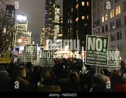 New York, New York, USA. 19th Jan, 2017. Protesters against Trump at Trump International Hotel in New York City - Stock Photo