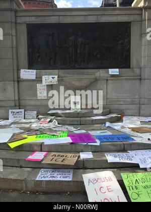 Boston, USA. 30th Jun, 2018. Discarded pro-immigration, anti-Trump signs left at the base of the 300th Anniversary Monument after the immigration rally on Boston Common today June 30, 2018. Credit: D Alderman/StockimoNews/Alamy Live News - Stock Photo