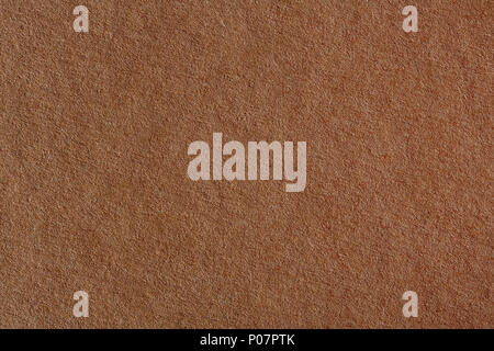 Sheet of brown paper useful as a background. - Stock Photo