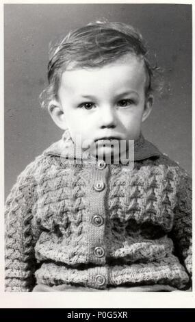 BRNO, THE CZECHOSLOVAK REPUBLIC, CIRCA 1972: A small boy retro photo.  Portrait photo was taken in photo studio. Early seventies.  Photo with dark tint, circa 1972. - Stock Photo