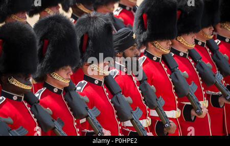 Horse Guards Parade, London, UK. 9 June, 2018. The world famous Queen's Birthday Parade, also known as Trooping the Colour, takes place with The Coldstream Guards Trooping their Colour in front of HM The Queen and an audience of over 7,500 guests at Horse Guards in hot sunshine. Guardsman Charanpreet Singh Lall is the first soldier to wear a turban on the historic parade. Credit: Malcolm Park/Alamy Live News. - Stock Photo