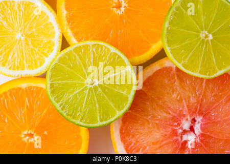 assorted sliced colourful citrus fruits - Stock Photo