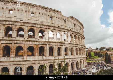 ROME, ITALY - 10 MARCH 2018: ancient Colosseum ruins with crowded square - Stock Photo