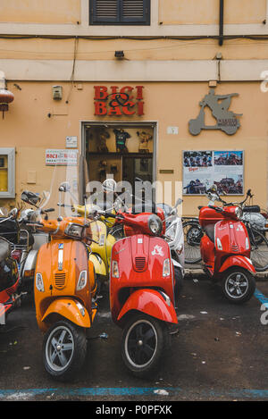 ROME, ITALY - 10 MARCH 2018: colorful scooters parked on street of Rome - Stock Photo