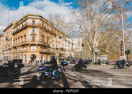 ROME, ITALY - 10 MARCH 2018: group of bikers riding by street of Rome - Stock Photo