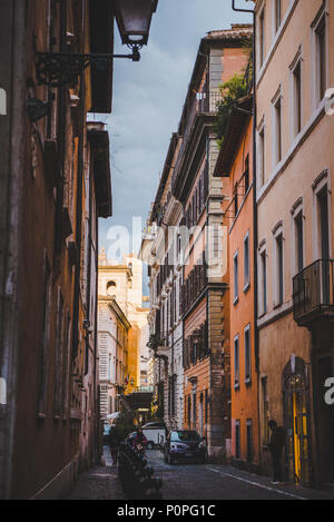 ROME, ITALY - 10 MARCH 2018: ancient buildings on narrow street of Rome - Stock Photo