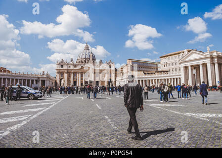 ROME, ITALY - 10 MARCH 2018: people walking by St. Peter's square - Stock Photo