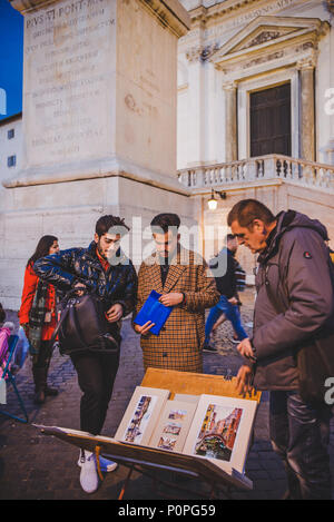 ROME, ITALY - 10 MARCH 2018: artist selling paintings on square - Stock Photo